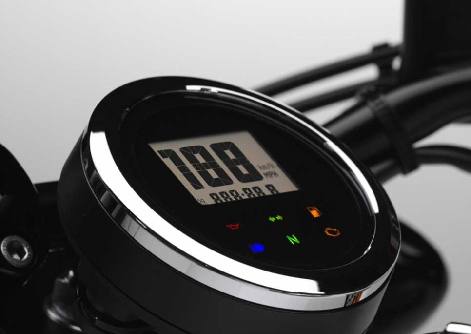 A round, smoked-lens LCD digital speedometer adds to the modern take on the traditional bobber style.