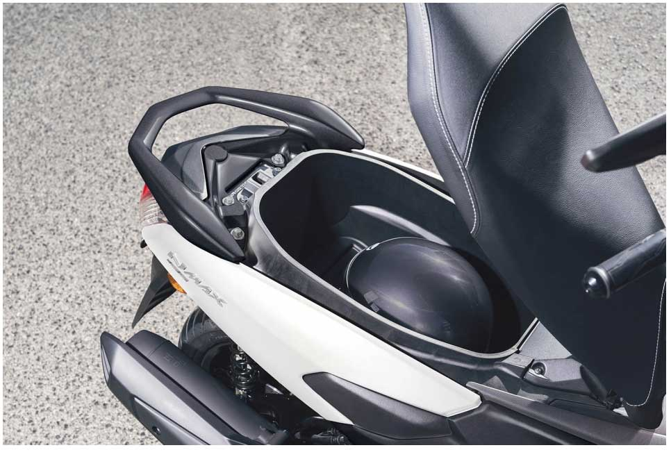 The compact NMAX 155 will fit into the tightest parking area - and yet while being small on the outside, you'll find the interior surprisingly spacious - with generous rider legroom and plenty of space for your passenger. The long stepped dual seat is designed to ensure high levels of comfort - and there's a storage compartment for a full-face helmet.