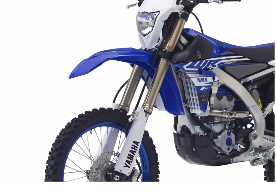 Increased rideability and comfort have been achieved on the WR250F through a number of revisions to the front and rear suspension. The class-leading Air Oil Separate (AOS) KYB front forks feature slightly reduced oil capacity and new factory suspension settings to give improved rider feedback and improved stability in ruts, bumps and corners.